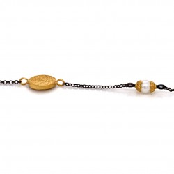 Bracelet with chain, adorned with a pearl and motif Festos disk