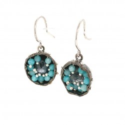 Black earrings of a hollow bezel with mobile semiprecious stones amazonite