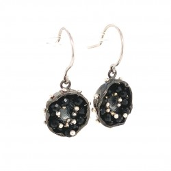 Black earrings of a hollow bezel with mobile semiprecious stones black spinel