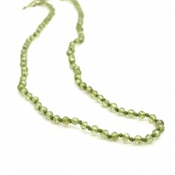 Peridot knotted necklace with 18K gold elements