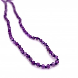 Amethyst knotted necklace with 18K gold elements