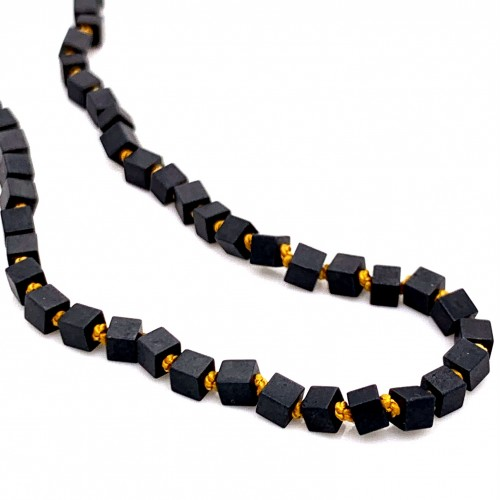 Hematite cube knotted necklace with 18K gold eleme...
