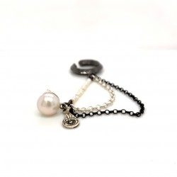 Black rhodium plated ear cuffs with a small charm protection eye and decorative pearls and chains