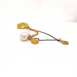 Gold plated ear cuffs with a small charm protection eye and decorative pearls and chains