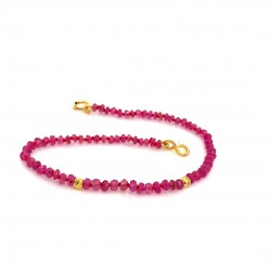 Ruby knotted bracelet with 18K gold elements