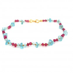 Ruby and aquamarine knotted bracelet with 18K gold elements