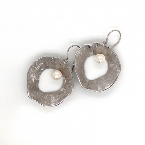 Earrings made from sterling silver with shell orga...